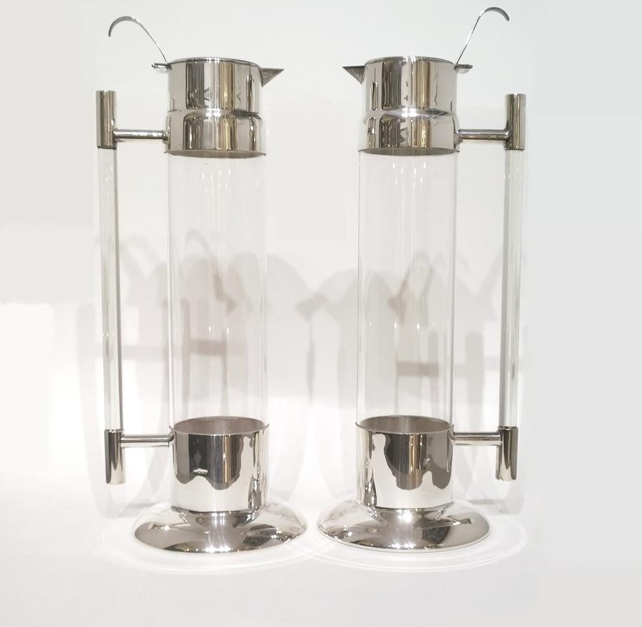 A pair of silver mounted glass claret jugs
