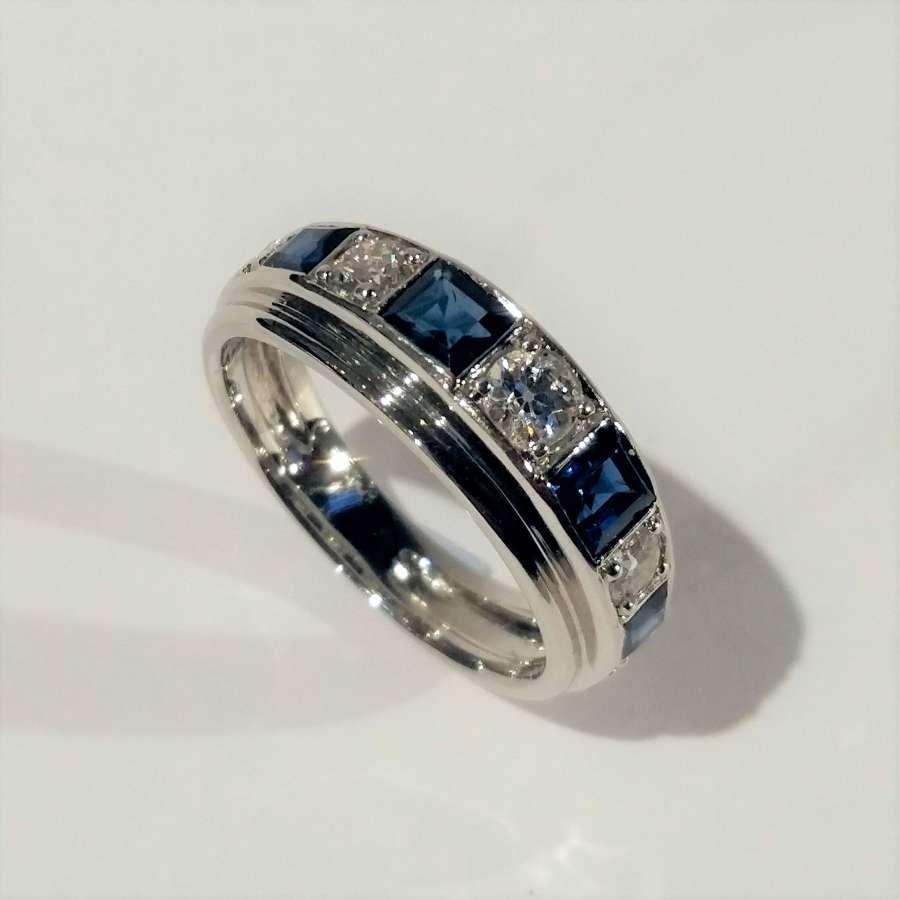 Sapphire and diamond half eternity ring.