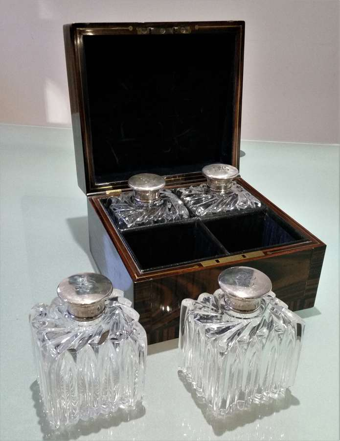 Set of perfume bottles in coromandel fitted box 1855